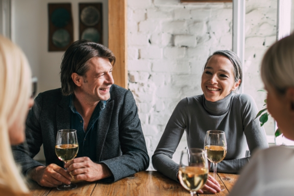 Couple with a glass of wine in a restaurant